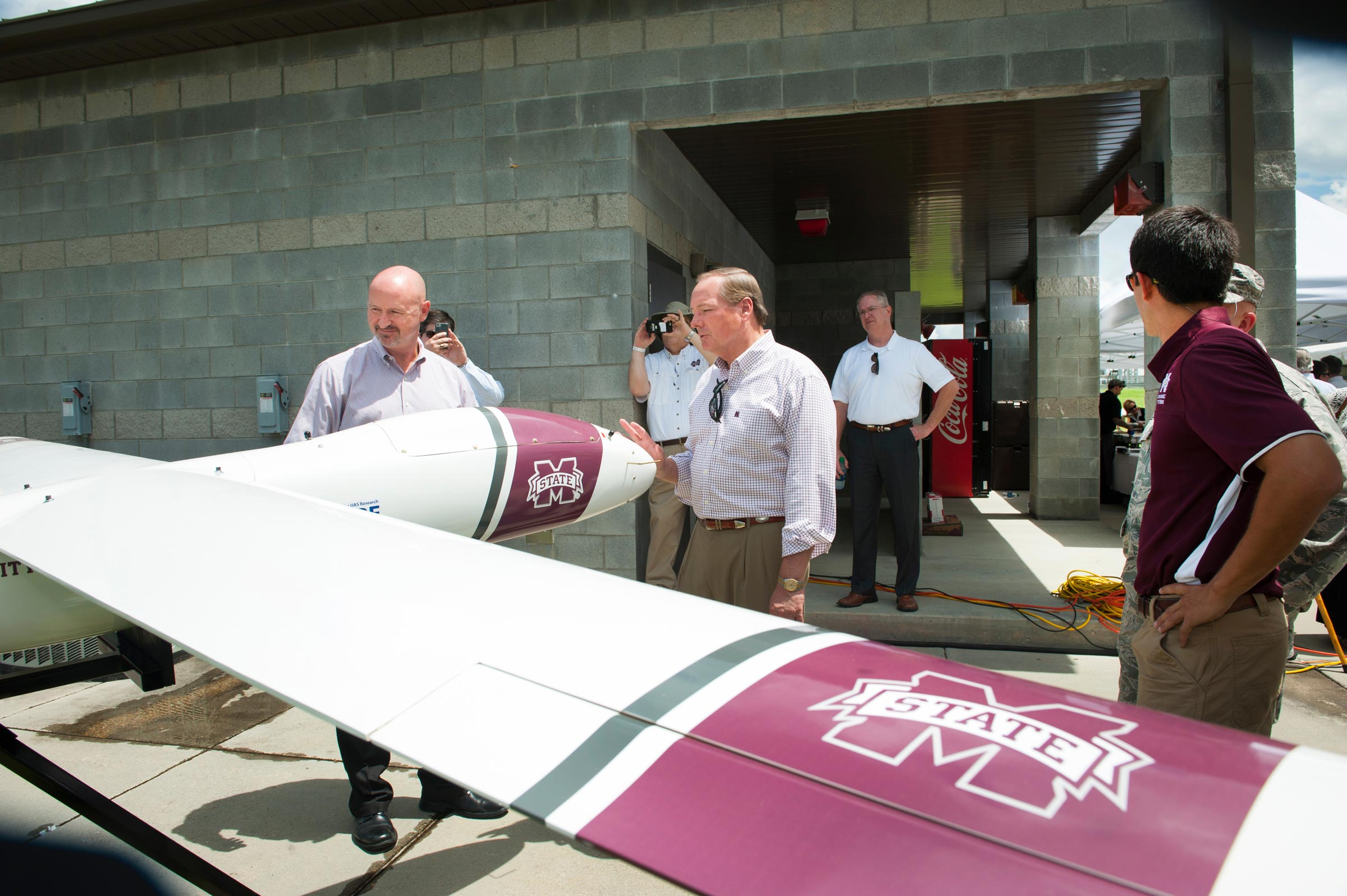Dallas Brooks and Mark Keenum next to unmanned plane